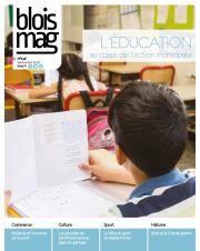 En couverture du Blois mag 146 (septembre 2018), une photo d'enfant tenant un cahier à sa table, au milieu d'une classe d'école.