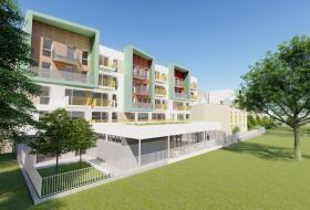Projection d'une façade de la résidence ouverte sur un grand terrain vert.