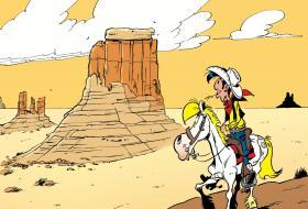 Dessin de Lucky Luke et Jolly Jumper contemplant le désert nord-américain.