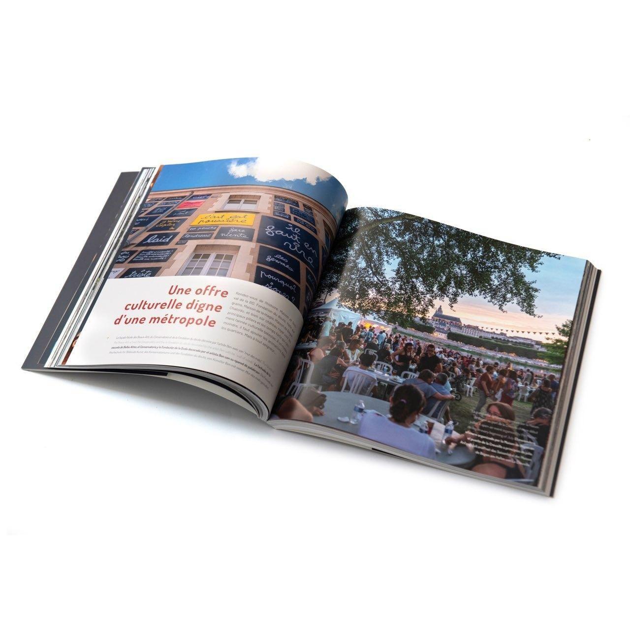 Le livre ouvert sur la rubrique «Une offre culturelle digne d'une métropole», avec comme photos le port de la Creusille pendant la Guinguette, et le Mur des mots de la Fondation du doute.